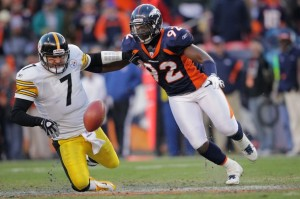 Ben Roethlisberger #7 of the Pittsburgh Steelers looses the ball against Elvis Dumervil #92 of the Denver Broncos during the AFC Wild Card Playoff game at Sports Authority Field at Mile High on January 8, 2012 in Denver, Colorado. (Doug Pensinger/Getty Images)