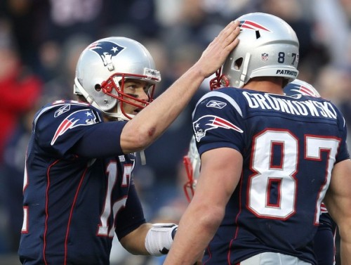 Tom Brady #12 of the New England Patriots celebrates with teammate Rob Gronkowski #87 of the New England Patriots after a touchdown against the Buffalo Bills in the second half at Gillette Stadium on January 1, 2012 in Foxboro, Massachusetts. (Jim Rogash/Getty Images)