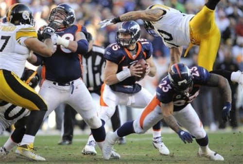 Denver Broncos running back Willis McGahee (23) throws a block on Pittsburgh Steelers inside linebacker Larry Foote (50) as Denver Broncos quarterback Tim Tebow (15) looks to pass in the second quarter of an NFL wild card playoff football game Sunday, Jan. 8, 2012, in Denver. (AP Photo/Jack Dempsey)