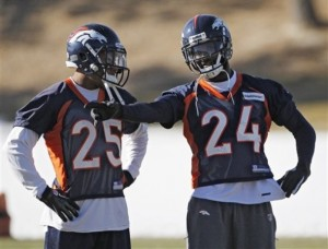 Denver Broncos cornerbacks Chris Harris (25) and Champ Bailey (24) confer during practice at the football team's training facility in Englewood, Colo., on Tuesday, Jan. 10, 2012. The Broncos are scheduled to playoff the New England Patriots in an NFL divisional playoff game on Saturday. (AP Photo/Ed Andrieski)