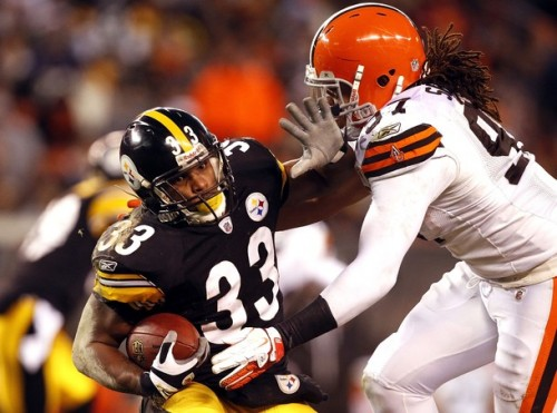 Running back Isaac Redman #33 of the Pittsburgh Steelers is hit by defensive lineman Jabaal Sheard #97 of the Cleveland Browns at Cleveland Browns Stadium on January 1, 2012 in Cleveland, Ohio.  (Matt Sullivan/Getty Images)