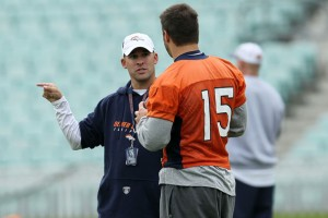 Former head coach of the Denver Broncos Josh McDaniels talks with Tim Tebow #15 during a team training session at The Brit Oval on October 29, 2010 in London, England. (Chris McGrath/Getty Images Europe)