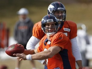 Denver Bronocs quarterback Brady Quinn throws a pass as quarterback Tim Tebow watches during NFL football practice in Englewood, Colo., on Wednesday, Jan. 4, 2012. The Broncos are scheduled to host the Pittsburgh Steelers on Sunday in a wild-card playoff game. (AP Photo/Ed Andrieski)