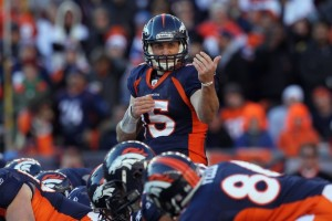 Quarterback Tim Tebow #15 of the Denver Broncos motions to a receiver during the AFC Wild Card Playoff game at Sports Authority Field against the Pittsburgh Steelers at Mile High on January 8, 2012 in Denver, Colorado. The Broncos defeated the Steelers in overtime 23-29. (Jeff Gross/Getty Images)