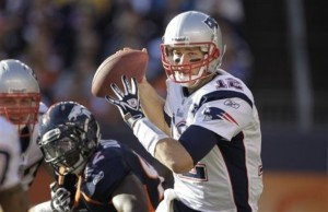 New England Patriots quarterback Tom Brady (12) looks to throw against the Denver Broncos in the first quarter of an NFL football game, Sunday, Dec. 18, 2011, in Denver. (AP Photo/Barry Gutierrez)