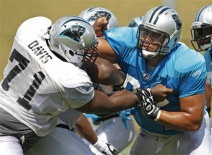 C.J. Davis (left) blocks Sione Fua (right) in August 2011. (AP Photo/Chuck Burton)