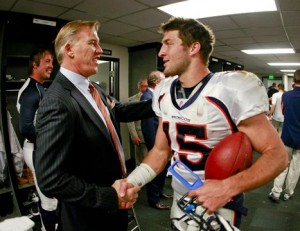 John Elway and Tim Tebow.  (Getty Images)