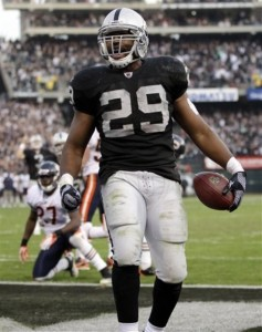 Michael Bush celebrates after scoring on a 3-yard run against the Chicago Bears during the fourth quarter of an NFL football game in Oakland, Calif., Sunday, Nov. 27, 2011. (AP Photo/Paul Sakuma)