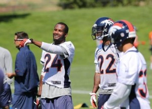 Cornerback Champ Bailey (24, left) talks with Tracy Porter (22, right).  (Image courtesy of Stuart Zaas/Denver Broncos)