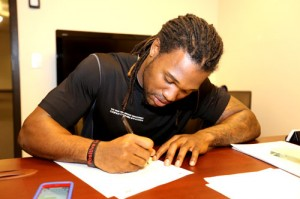 Omar Bolden signs his contract