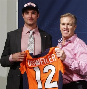 Denver Broncos vice president John Elway, right,  poses with Brock Osweiler the teams second draft pick in the 2012 NFL football draft at the Denver Broncos headquarters in Englewood, Colo., on Saturday, April 28, 2012. Osweiler was a quarterback at Arizona State. (AP Photo/Ed Andrieski)