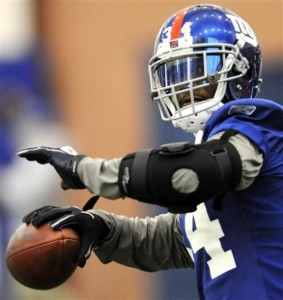 New York Giants safety Deon Grant looks to throw a pass during NFL football practice Friday, Jan. 27, 2012, in East Rutherford, N.J. The Giants are scheduled to face the New England Patriots in Super Bowl XLVI on Feb. 5 in Indianapolis. (AP Photo/Bill Kostroun)