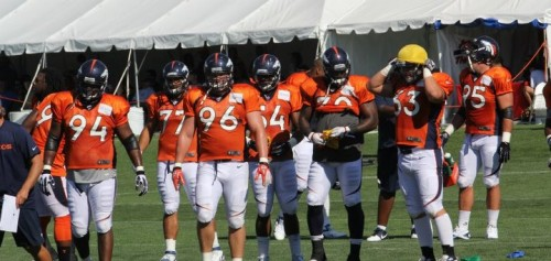 Broncos defensive linemen at practice