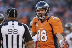 Peyton Manning comments to side judge Greg Bradley in the second quarter of an NFL football game, Sunday, Dec. 2, 2012, in Denver. (AP Photo/Joe Mahoney)